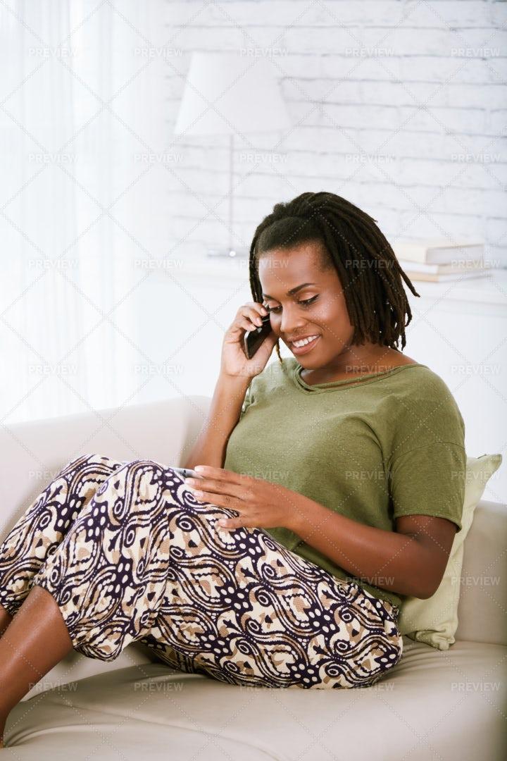 Smiling Woman Resting On Sofa: Stock Photos