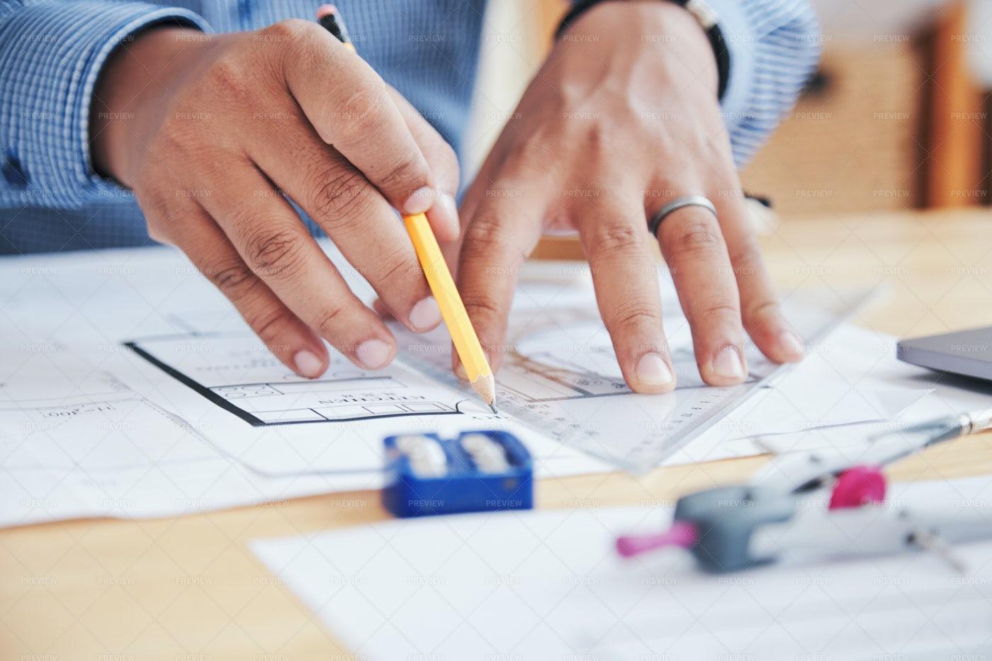 Hands Working On Blueprint: Stock Photos