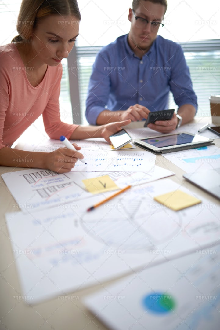 Coworkers Analyzing Financial Data: Stock Photos