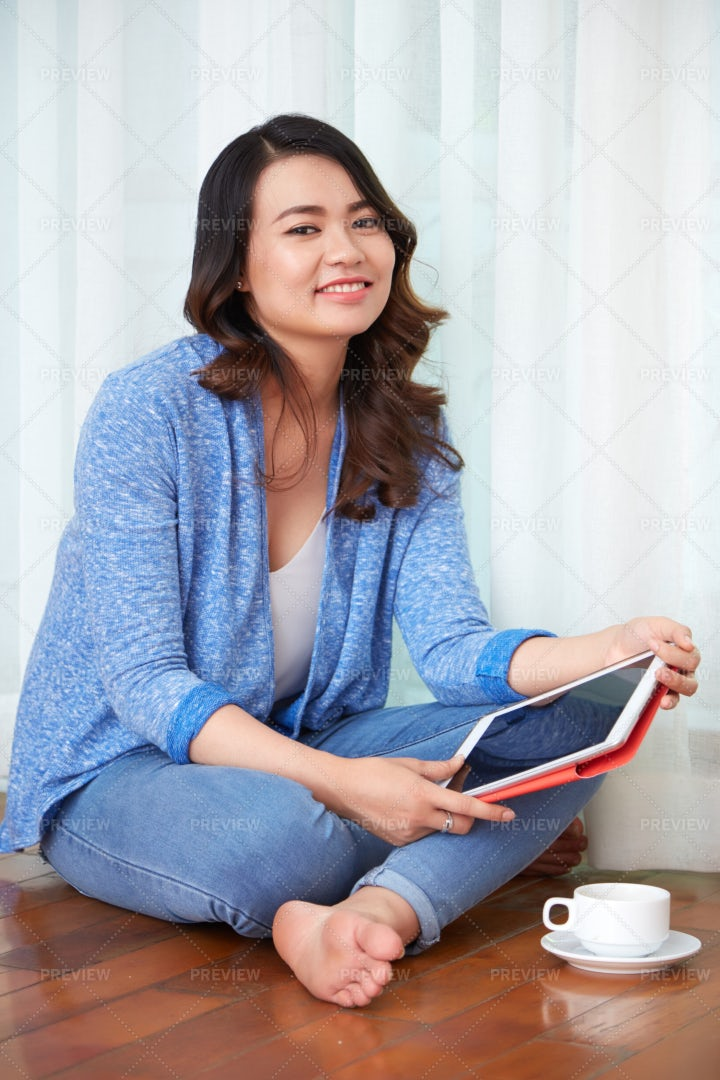 Woman With Digital Tablet Drinking...: Stock Photos