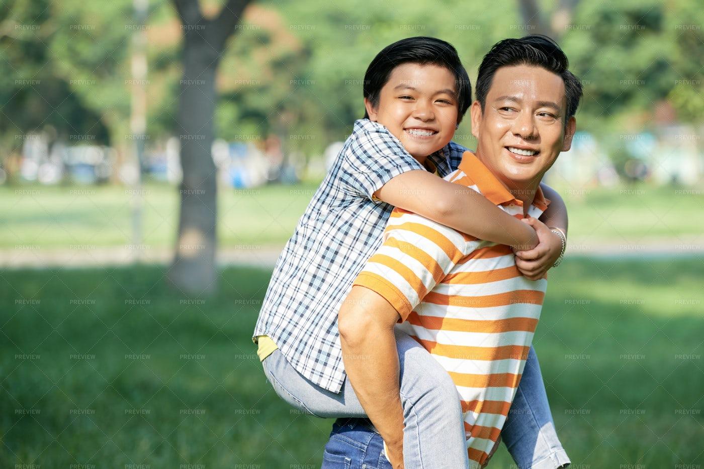 Giving Piggyback Ride To Little Son: Stock Photos