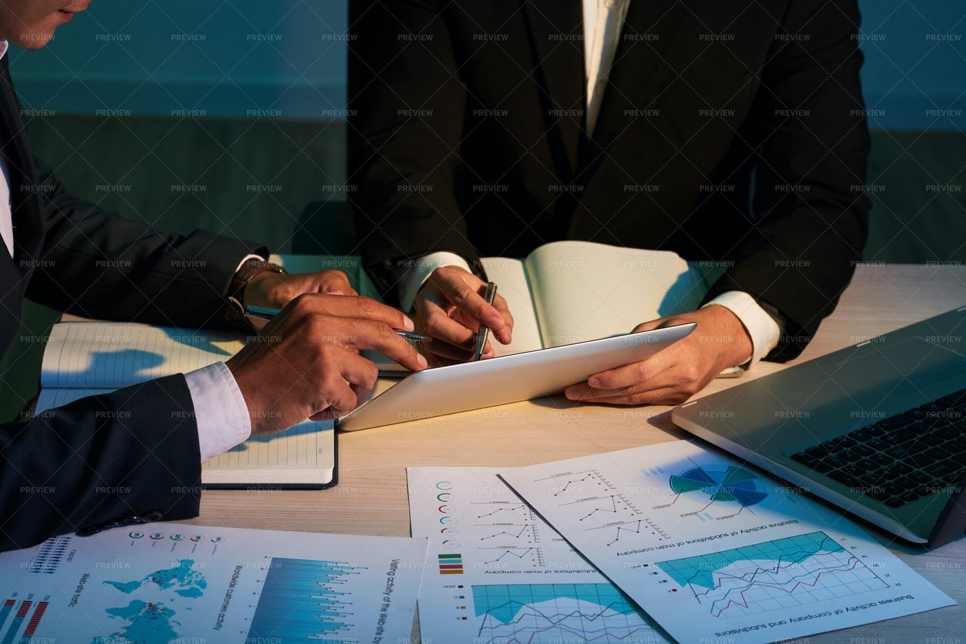 Colleagues Working With Business...: Stock Photos