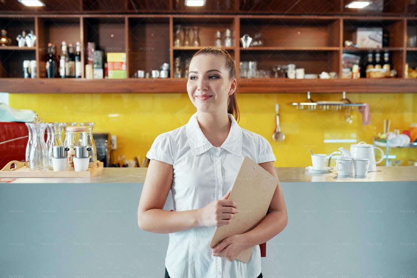 Content Woman With Clipboard...: Stock Photos