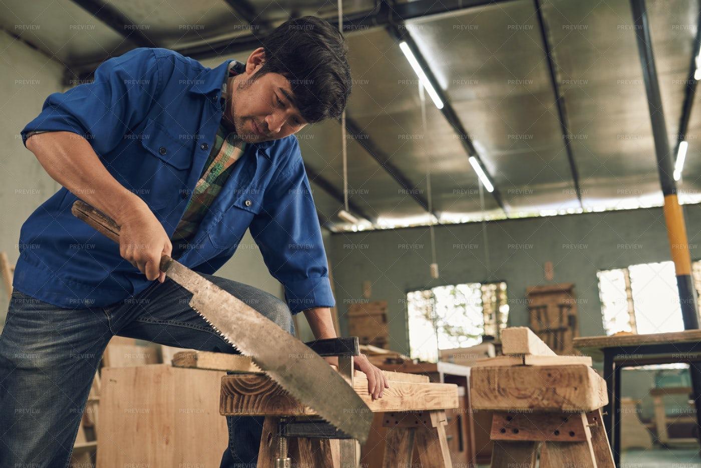 Sawing Man: Stock Photos