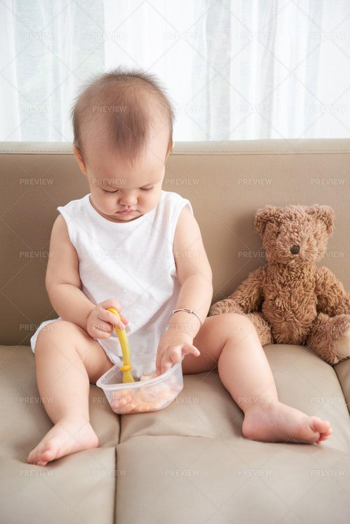Eating Baby Girl: Stock Photos