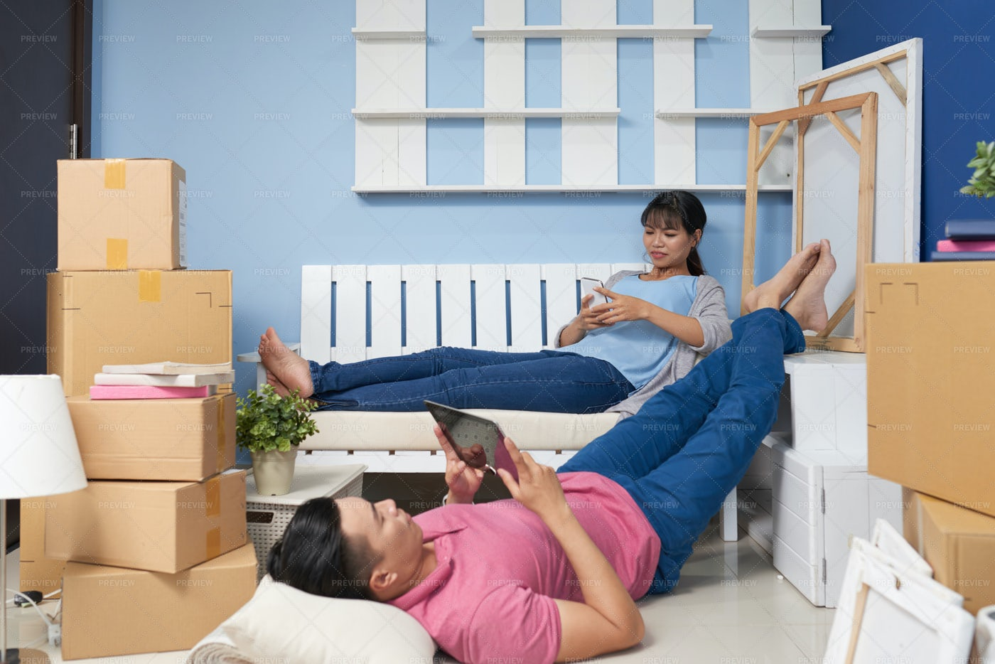 Couple Resting After Moving In New...: Stock Photos