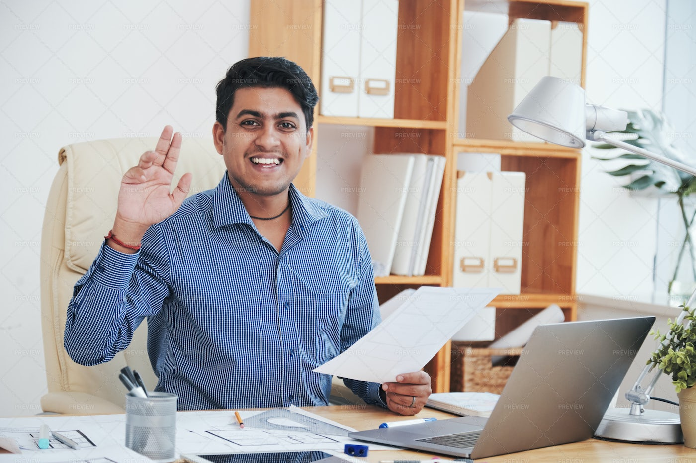 Cheerful Worker With Papers: Stock Photos