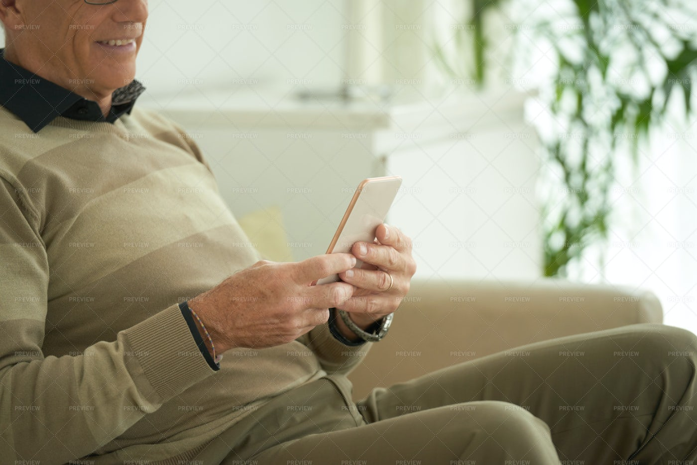 Aged Man With Smartphone: Stock Photos