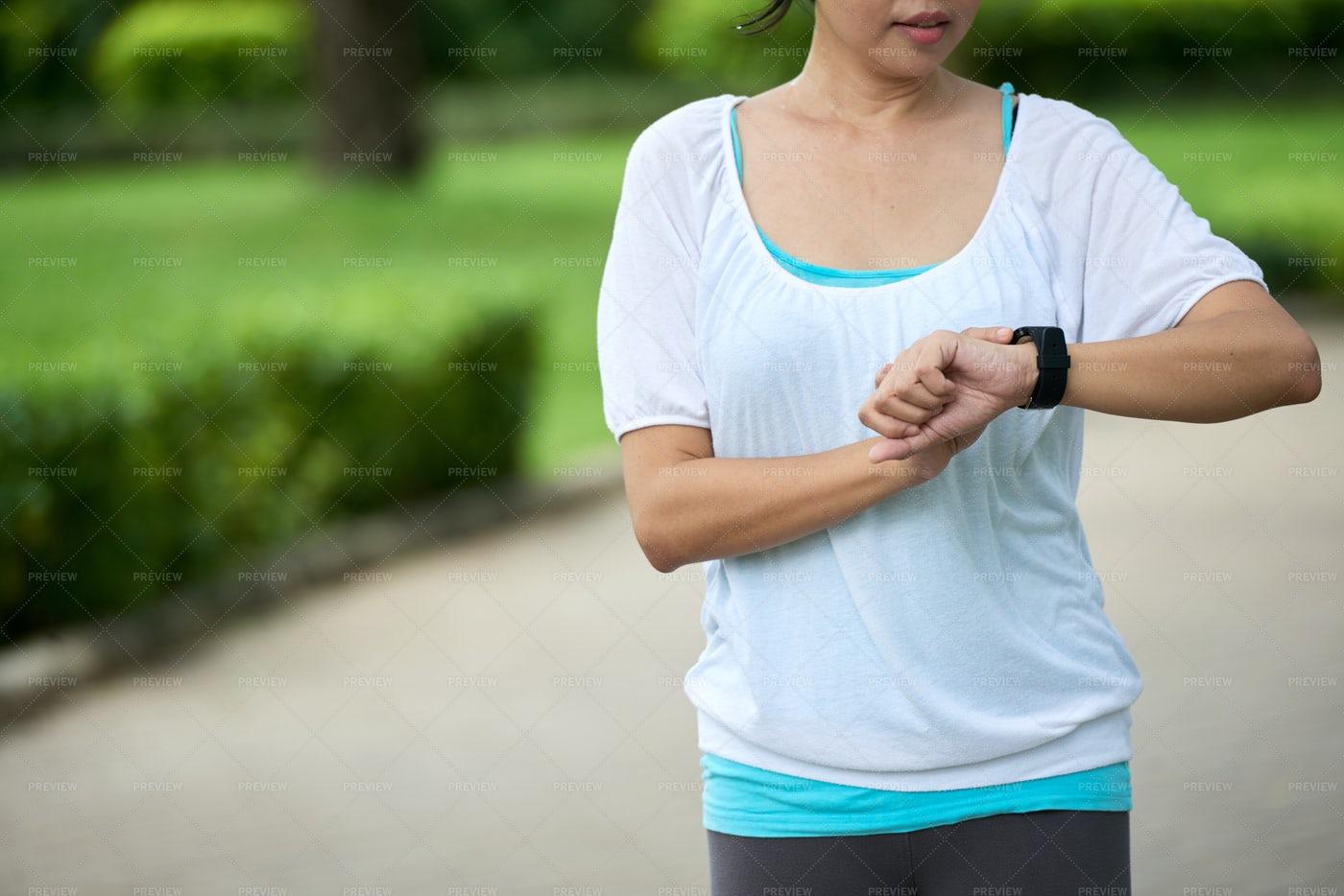 Woman Checking Fitness Bracelet: Stock Photos