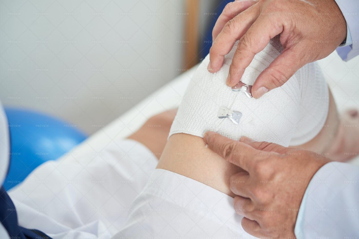 Applying Elastic Bandage: Stock Photos