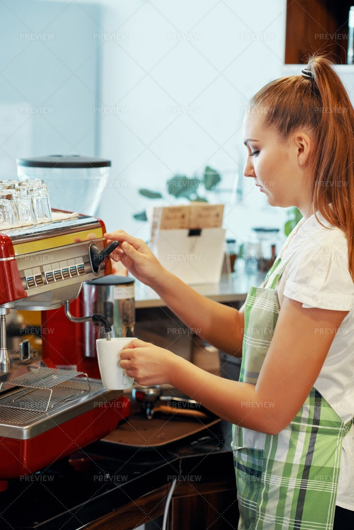 Young Barista Making Coffee In...: Stock Photos