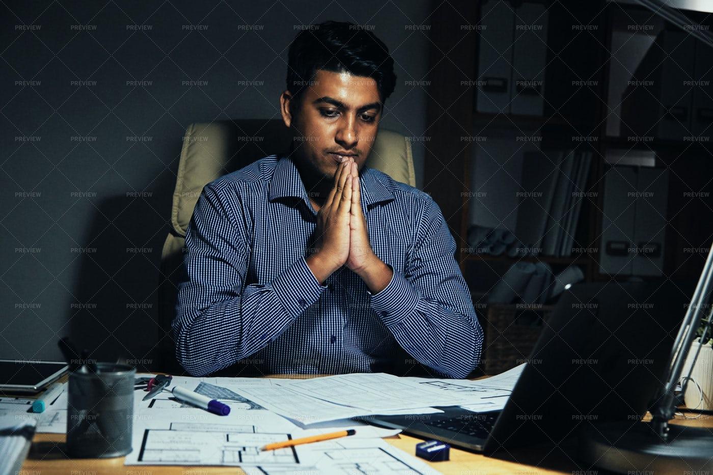 Ethnic Man Praying In Office: Stock Photos