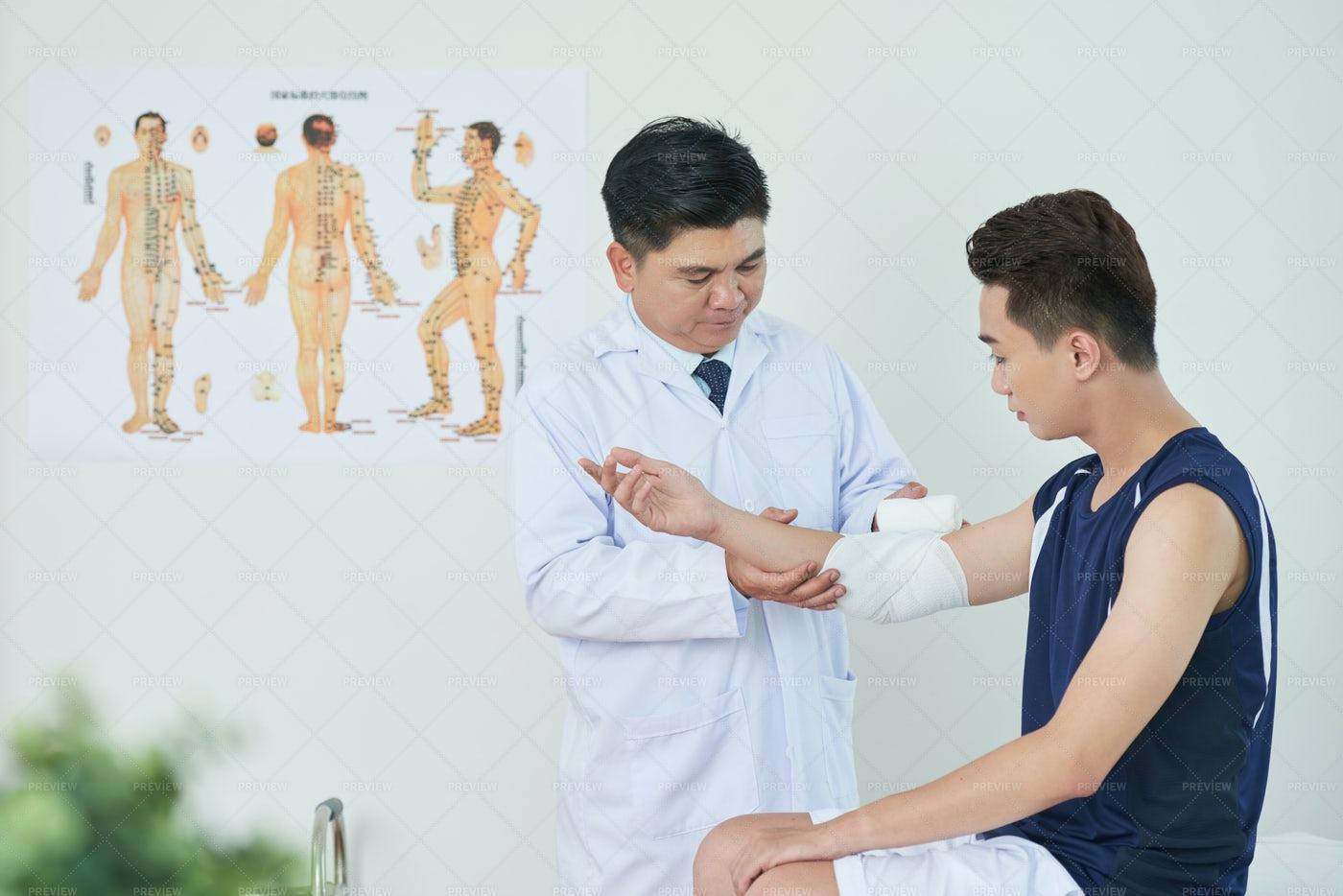 Changing Arm Bandage: Stock Photos