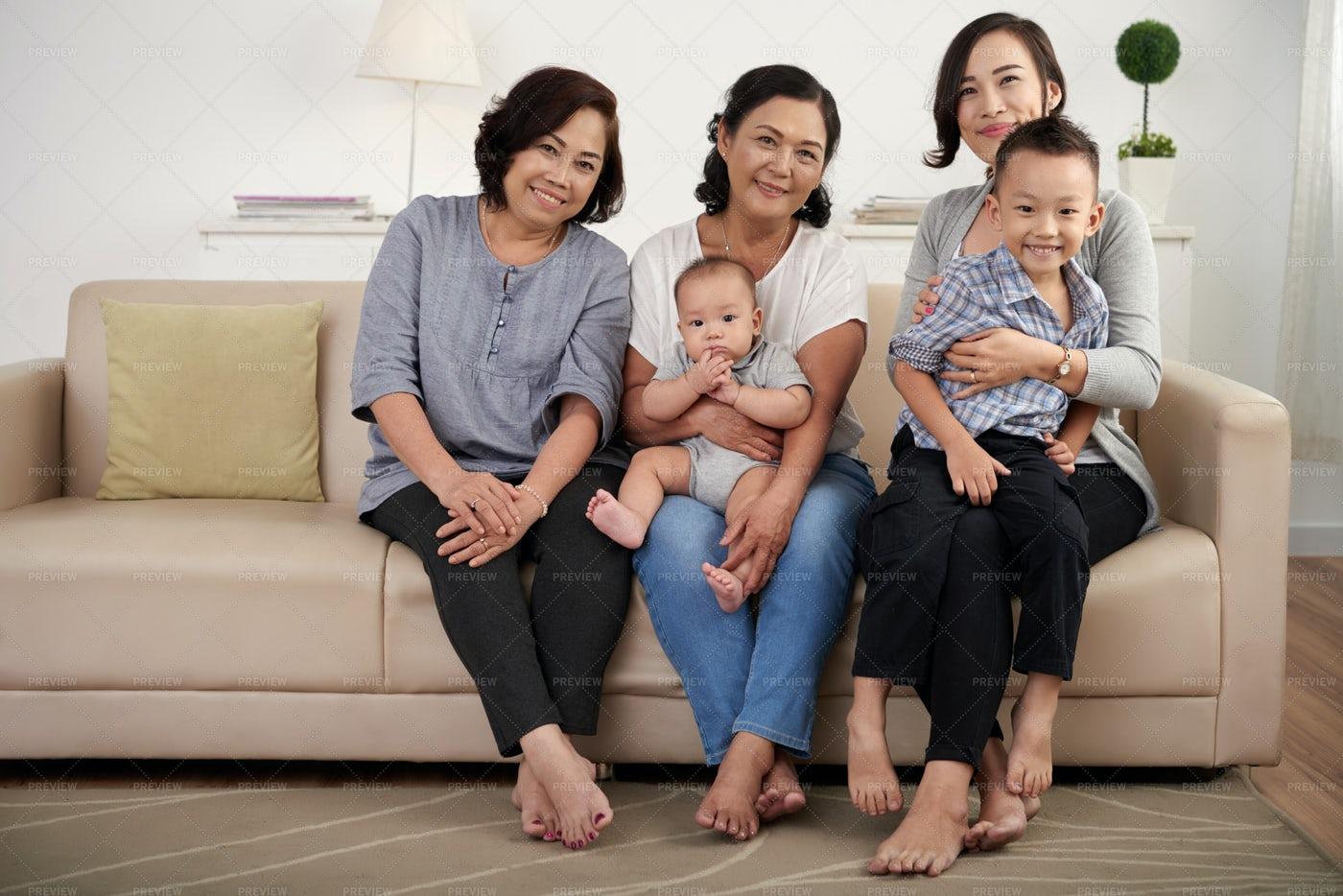 Happy Asian Family Posing At Home: Stock Photos