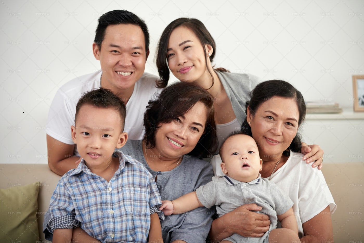 Happy Asian Family Posing Together: Stock Photos