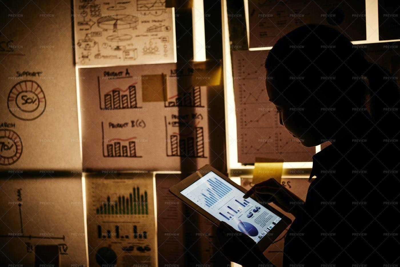 Examining Financial Chart: Stock Photos