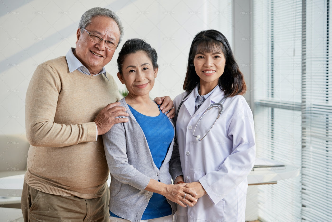 Asian Doctor With Senior Patients: Stock Photos