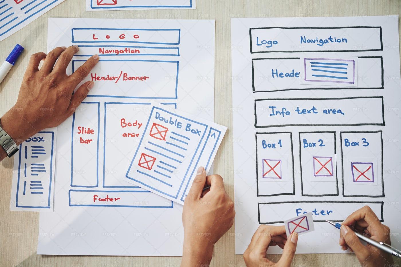 Crop Colleagues Creating Website...: Stock Photos