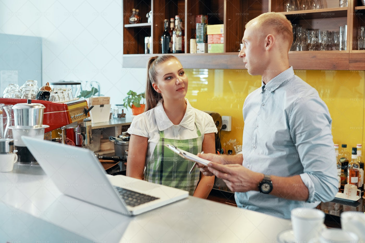 Talking Manger And Barista In...: Stock Photos