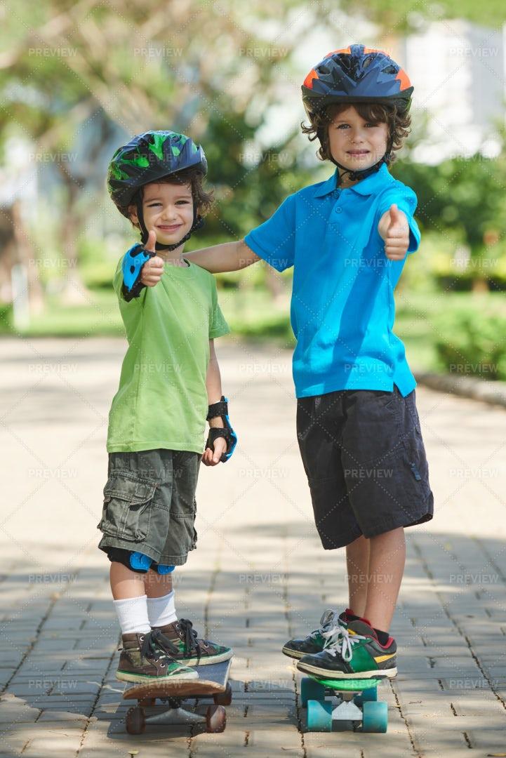 Cheerful Little Boys Skateboarding...: Stock Photos