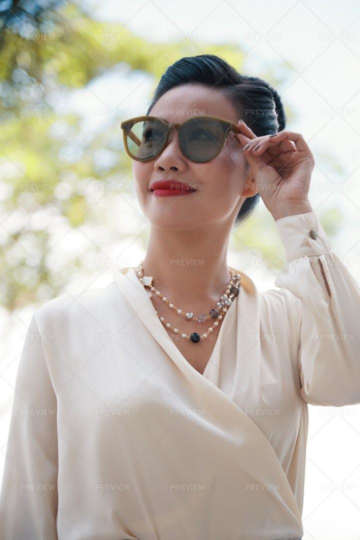 Smiling Businesswoman Touching...: Stock Photos
