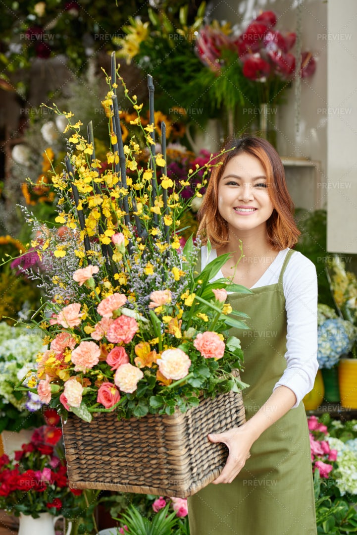 Florist With Basket Of Flowers: Stock Photos