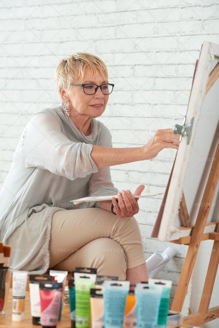 Concentrated On Painting: Stock Photos
