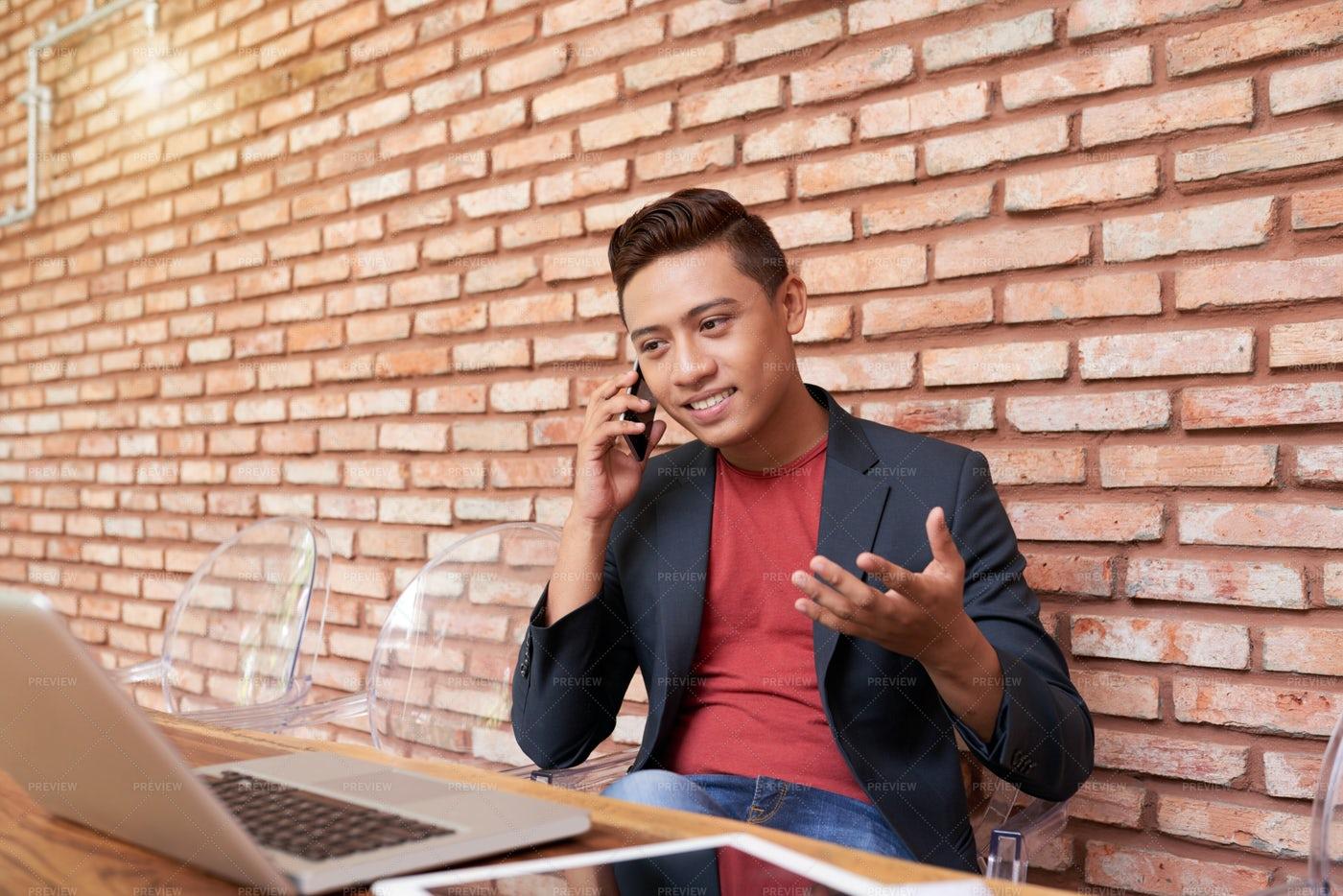 Contemporary Asian Businessman...: Stock Photos