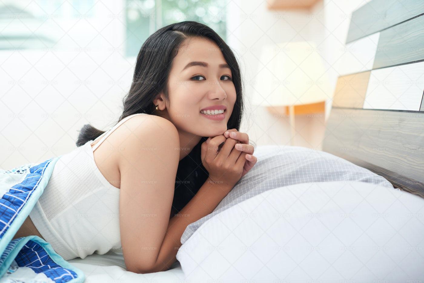 Beautiful Asian Woman Under Blanket...: Stock Photos