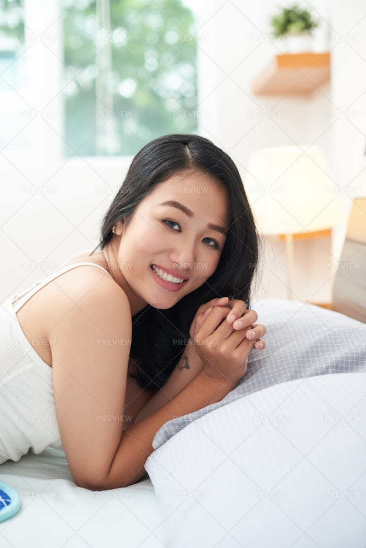 Pretty Ethnic Woman Lying In Bed: Stock Photos