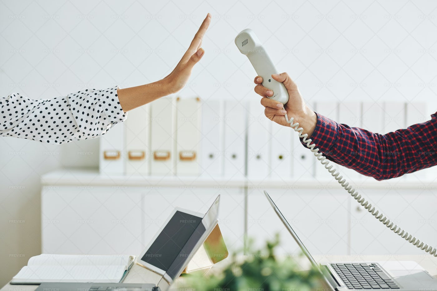 Woman Rejecting Call In Office: Stock Photos