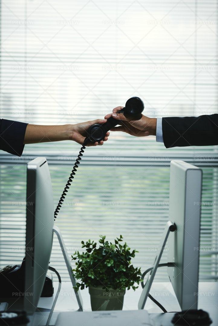 Passing Telephone Receiver: Stock Photos