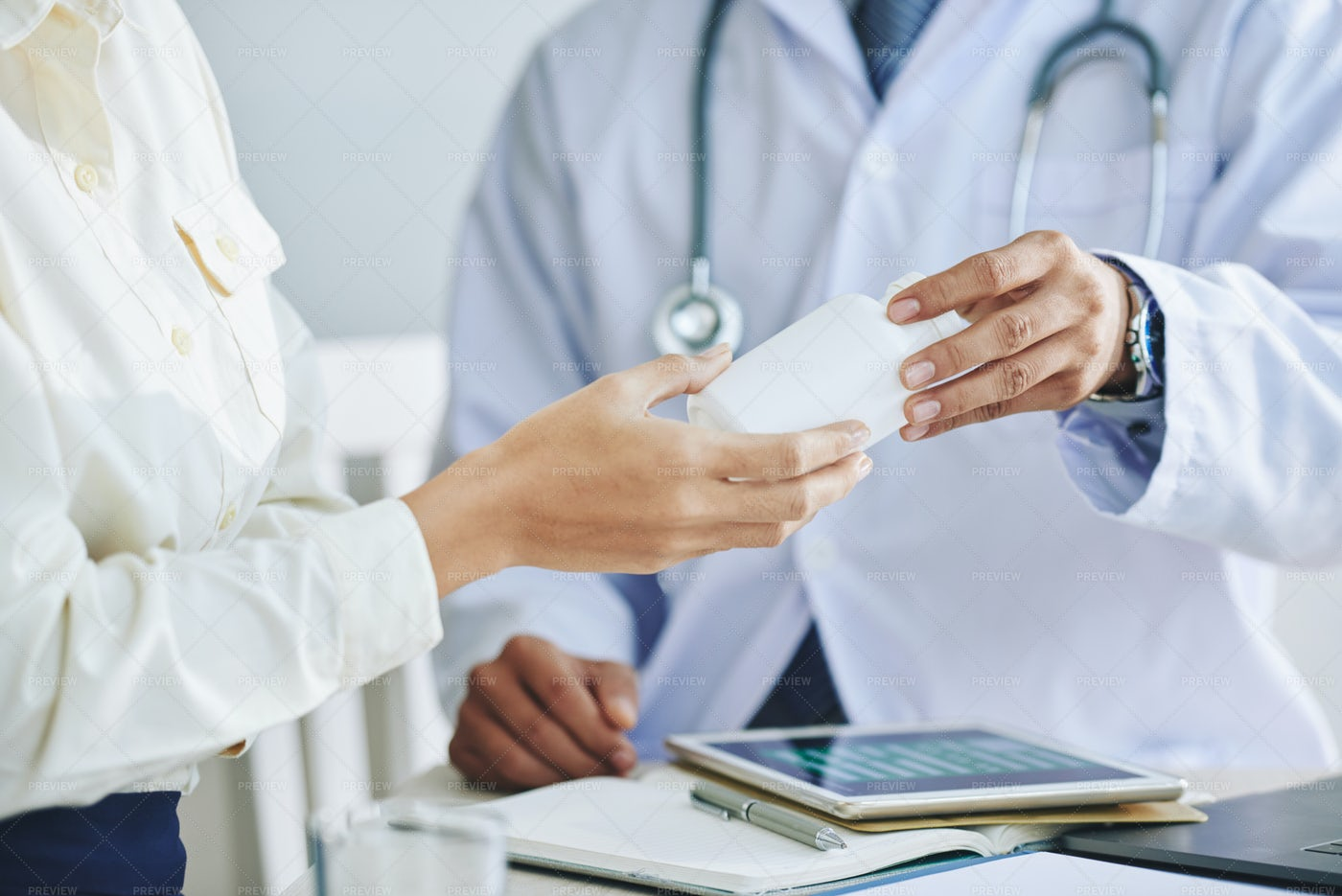 Doctor Giving Medicine To Patient: Stock Photos