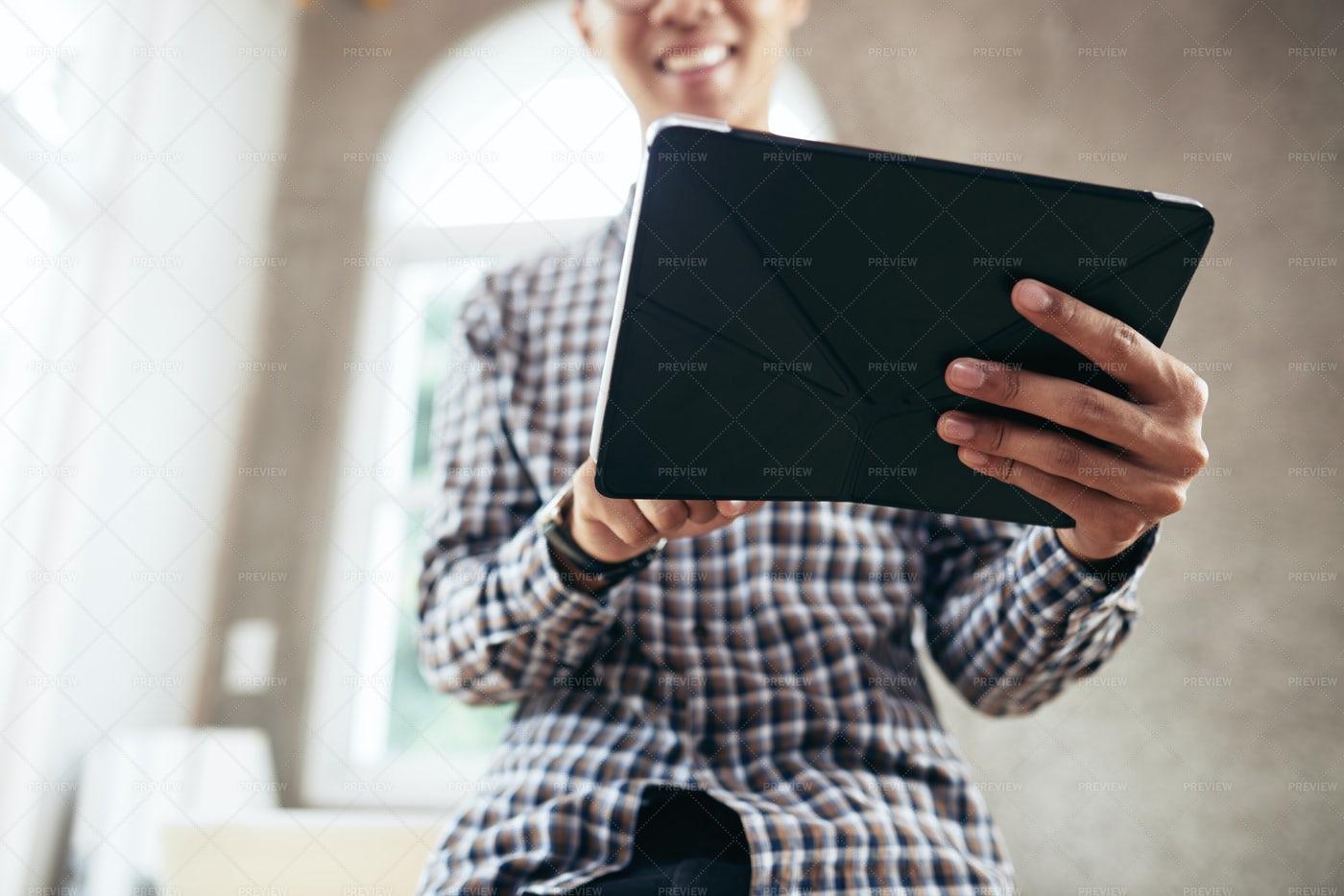 Man Holding Tablet: Stock Photos