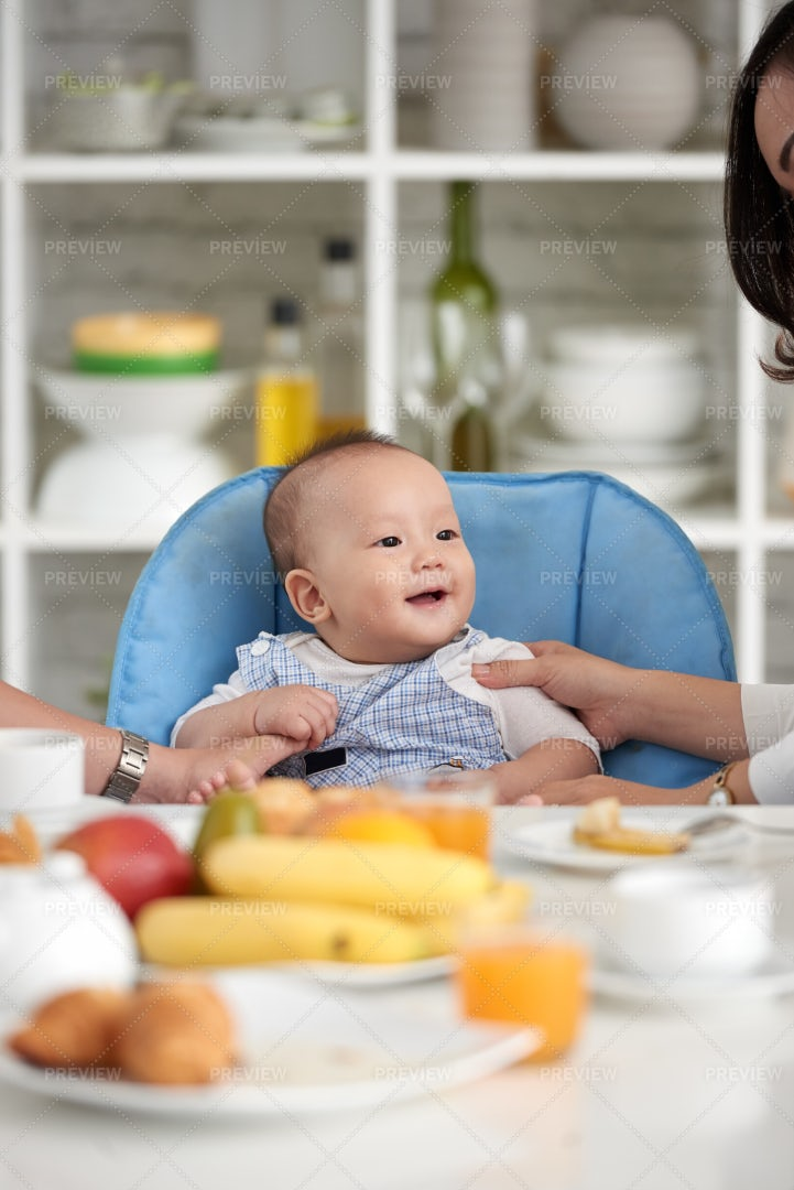Cute Asian Baby At Dining Table...: Stock Photos