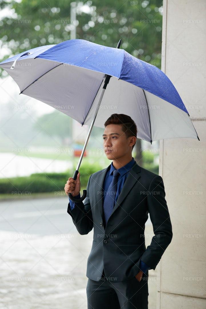 Handsome Asian Gentleman Waiting In...: Stock Photos