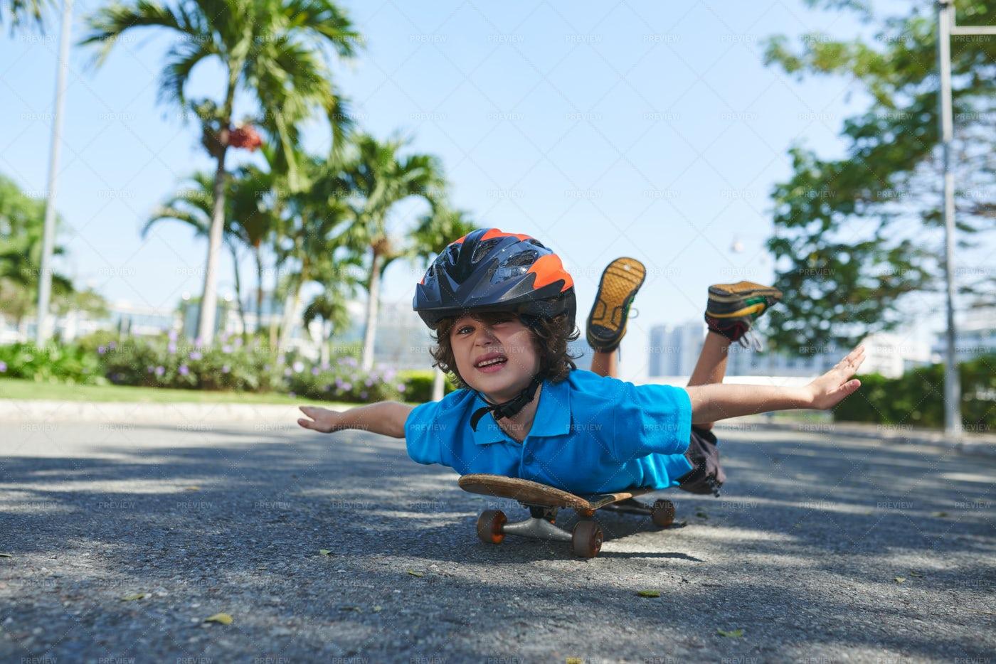Funny Little Boy On Skateboard: Stock Photos