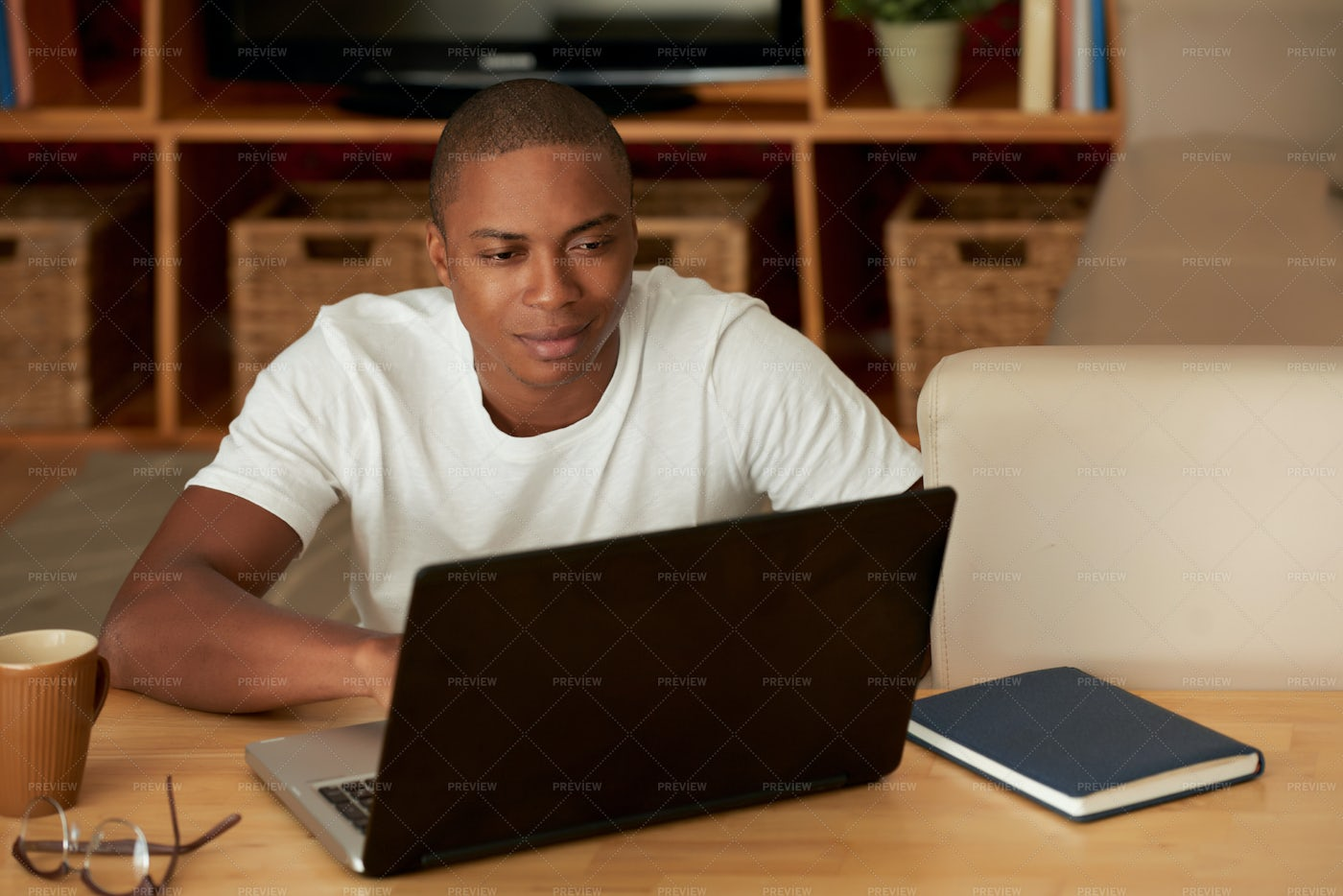 Young Man Working From Home: Stock Photos