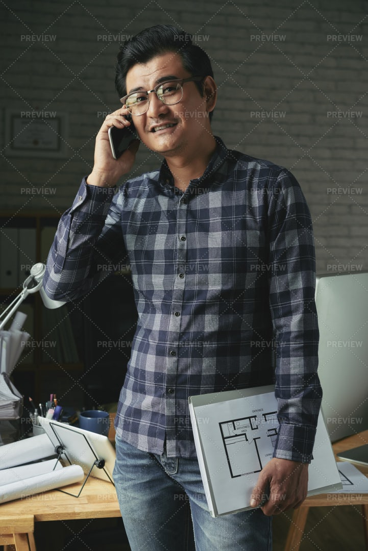Engineer Calling On Phone: Stock Photos