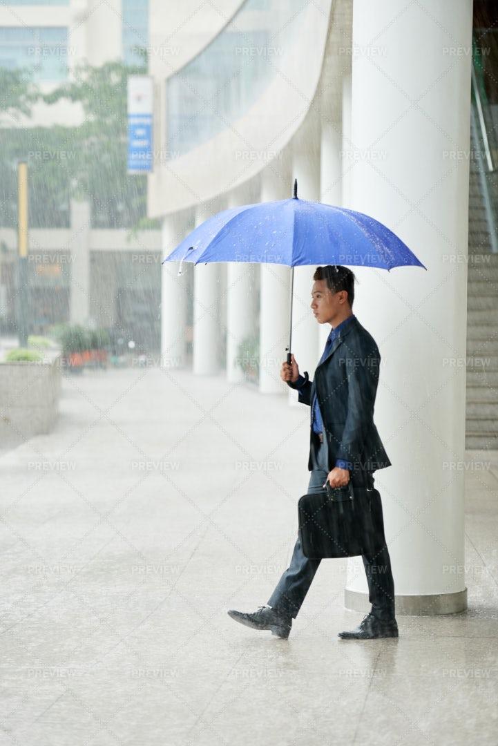 Young Asian Businessman In Rainy...: Stock Photos