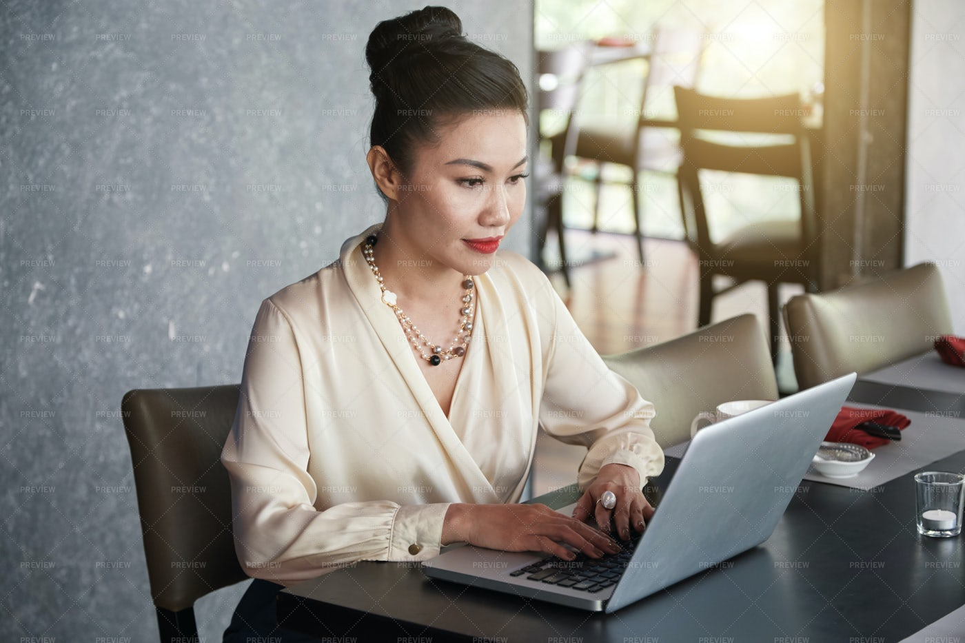 Elegant Asian Female With Laptop At...: Stock Photos