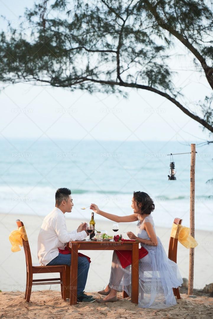 Joyful Couple Having Dinner On...: Stock Photos