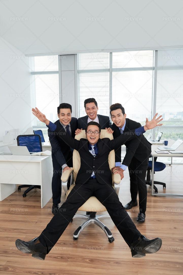 Joyful Managers Posing For...: Stock Photos
