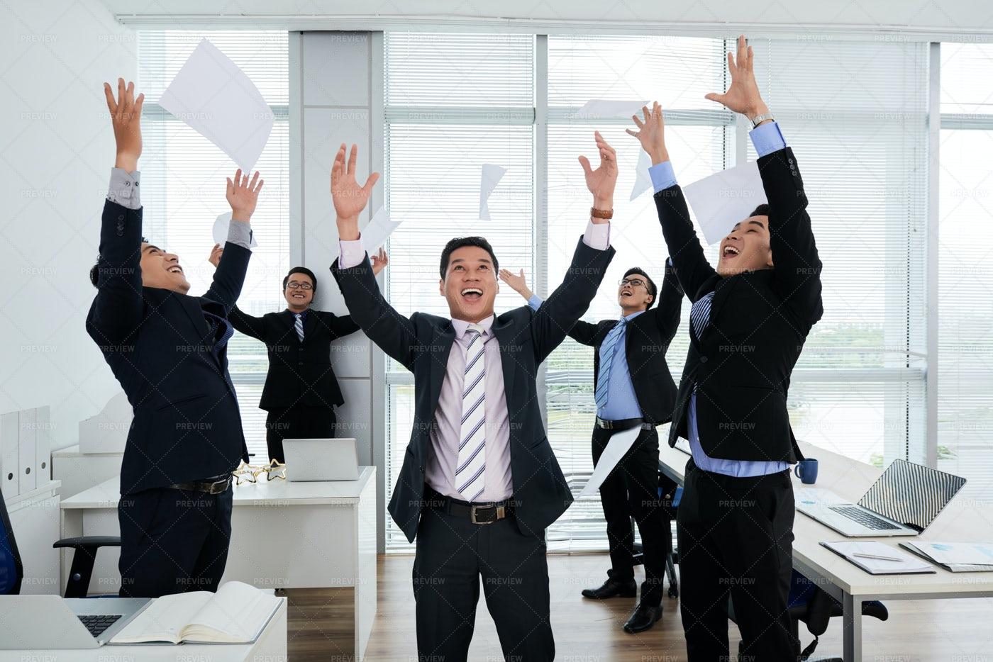Asian Colleagues Celebrating...: Stock Photos