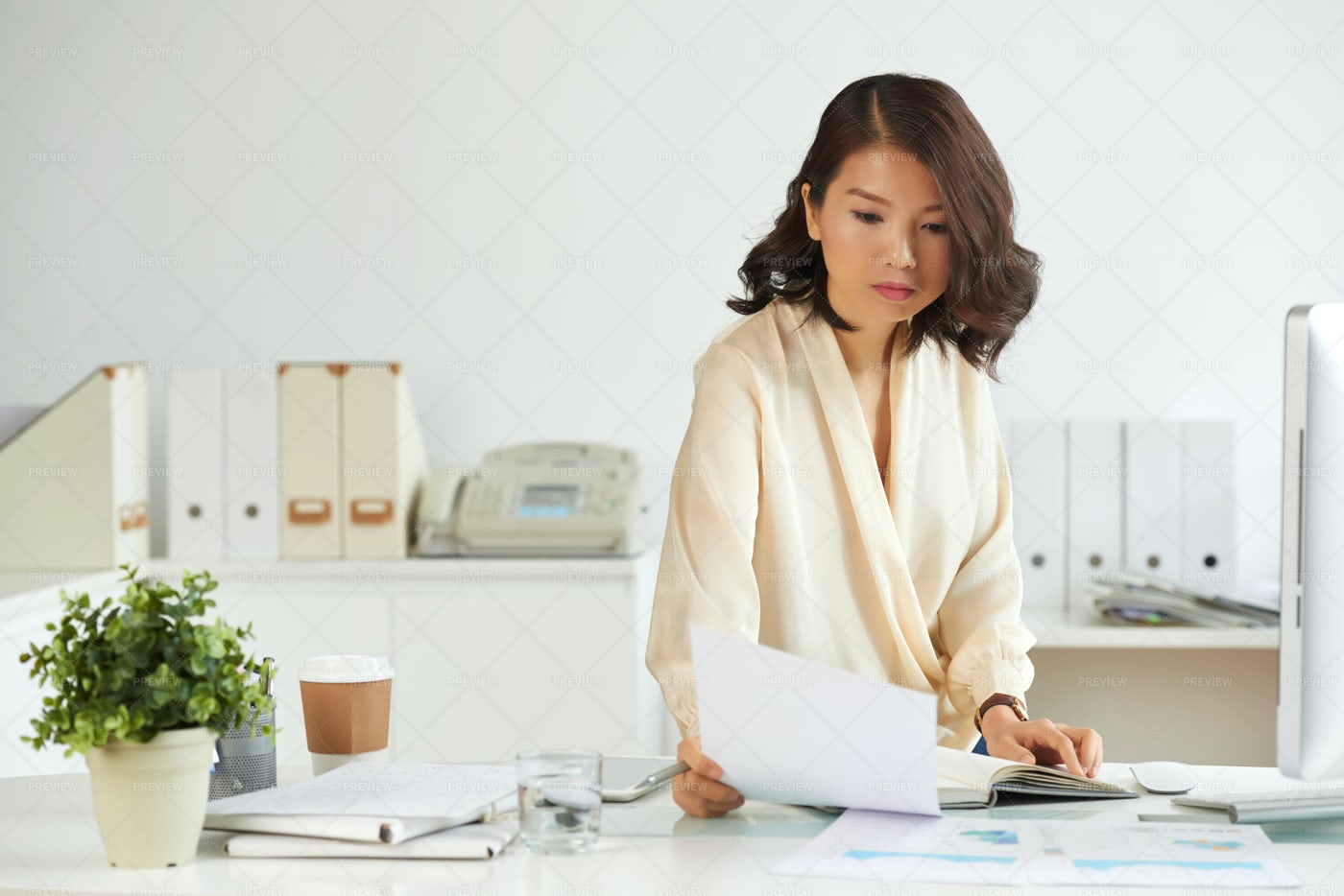 Business Lady Reading A Contract: Stock Photos