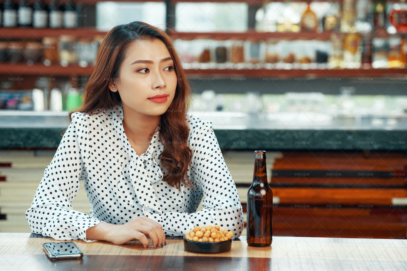 Pretty Woman Waiting In Bar: Stock Photos