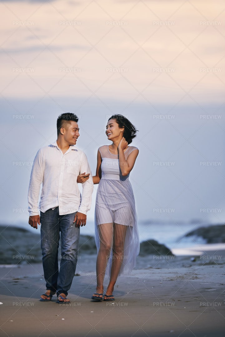 Couple Walking On Beach: Stock Photos