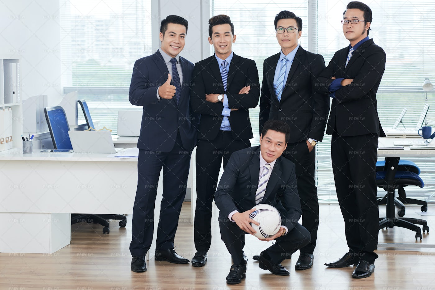 Football Fans At Workplace: Stock Photos