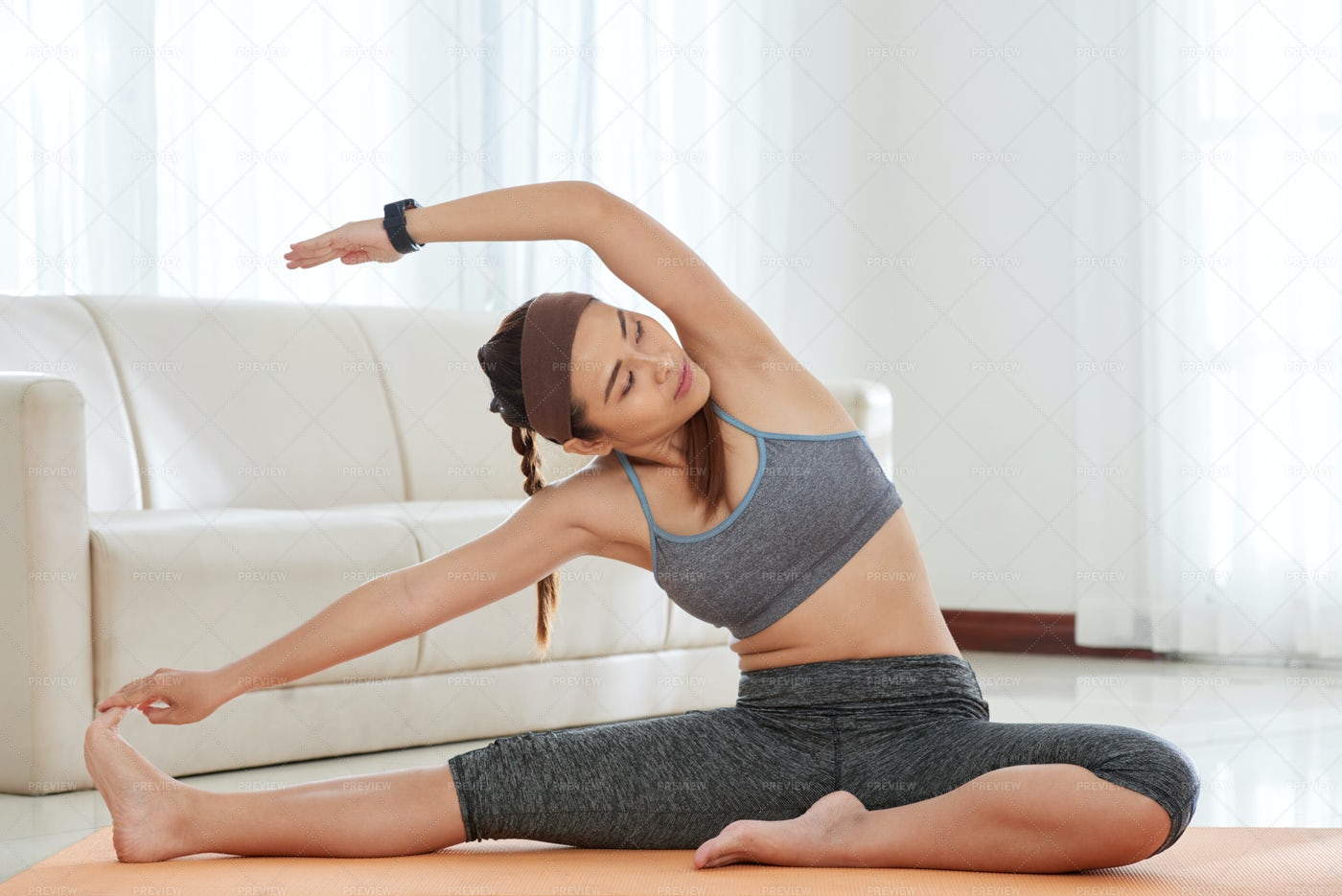 Woman Stretching At Home: Stock Photos