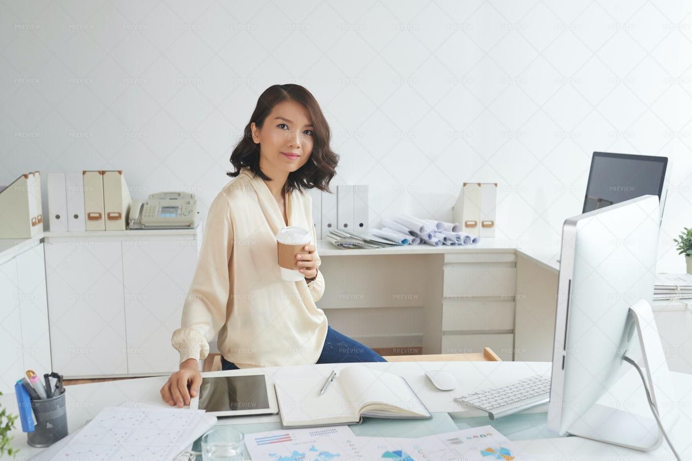 Asian Secretary At Workplace: Stock Photos